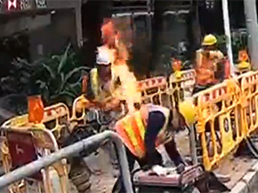 Man on fire put out by bucket of fuel