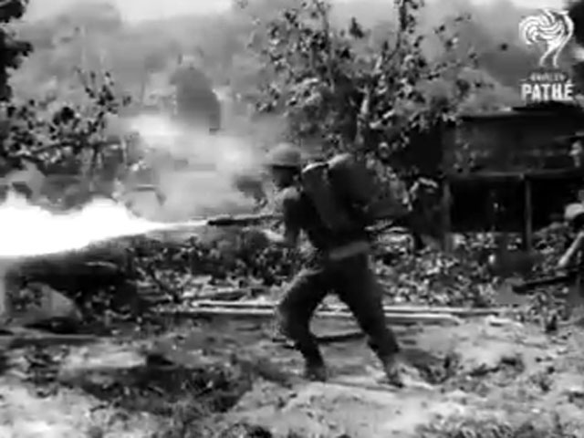 Australian soldier killing with a flame thrower