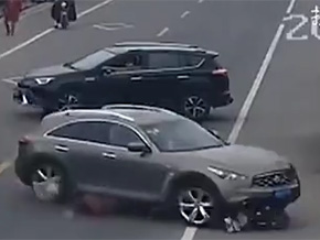 Lexus suv runs over motorcyclist